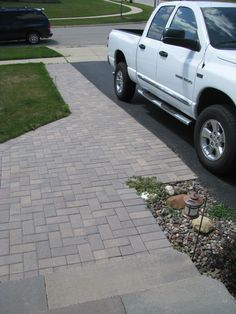 Show some curb appeal as you drive up to see this brick driveway extension and sidewalk. Blends in naturally. Front Driveway Ideas, Brick Paver Driveway, Front Yard Walkway, Diy Driveway, Front Yard Decor, Driveway Design, Driveway Landscaping, Paver Walkway, Fence Ideas