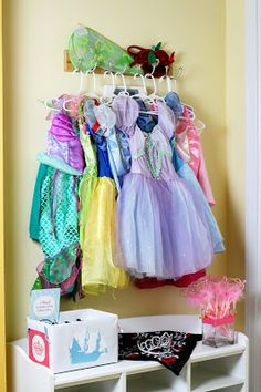 Piece of Cake: Classic Princess & Pirate Real Party Feature Put out princess dresses by the front door so the guests can choose a gorgeous outfit to wear at the party