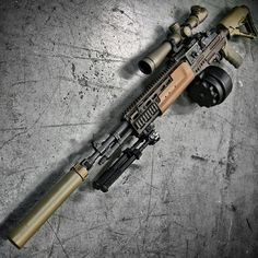 The Smith Enterprise Crazyhorse M1A with EBR Chassis, X14 drum, MK 4 LR/T Rifle scope & SOCOM can, and Atlas bipod.