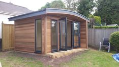 x Curved Roof Cedar Clad Garden Office with uPVC Double Glazed Anthracite Windows and Doors Backyard Office, Garden Office, Small Space Living, Small Spaces, Corner Log Cabins, Cedar Cladding, Cedar Garden, Windows And Doors, Winchester