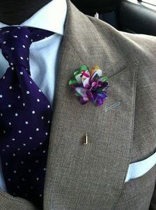 Image of purple floral lapel flower