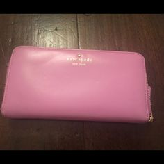 Lavender Kate Spade Wallet Lovely lavender wallet with a slight pink hue.        Used but in great condition.                                   The inside lining is white with colorful polka dots.   Great for spring!!! kate spade Bags Wallets