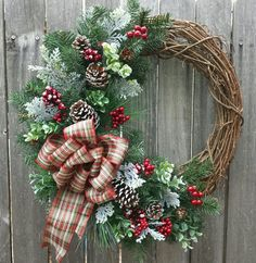 Christmas Winter Frosted Wreath with Berries and Pinecone's $50+shipping contact me at cathdun68@hotmail.com Handmade. I can custom make any wreath to match your decor.