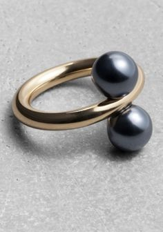 & OTHER STORIES A chunky brass ring with elegant details that resemble pearls.