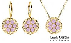 14K Yellow Gold over .925 Sterling Silver Pendant and Earrings Set Amazingly Designed by Lucia Costin Enriched with Filigree Ornaments and Lilac Swarovski Crystal Flowers Lucia Costin. $104.00. Style takes wings in this lovely jewelry set that have a graceful flower shape. Handmade in USA unique jewelry set. Dangle ornaments accented with floral design. Adorned with light purple Swarovski crystals. Lucia Costin set of jewelry