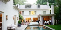 Suzanne Kassler | Perfect outdoor entertaining. Love the covered porch with FP.