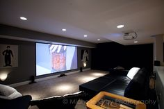 Home Theatre / Movie Room created on a shoe string budget. Entire room was created and furnished for less than $1,000 with the help of IKEA and some paint. Room features surround sound, 3D Projector & 9-foot screen.
