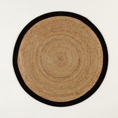 Aftas round rug. This rug which is set off by a contrasting colourful border, brings a natural and authentic touch to the home, creating a wonderful effect.Aftas round rug:90% jute, 10% cotton, 3500g/m².Braided cotton border.Size of Aftas round rug:Diameter: 100cmFor home delivery:Your Aftas jute rug will be delivered to your door!Note! Please check that all access points are large enough to accommodate your delivery (doors, stairs, lifts).