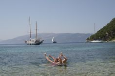 Two week 2 swimmers celebrate swimming the furthest they have ever swam after the 5k heroic Kefalonia to Ithaca crossing
