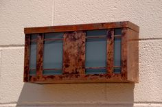 Custom mailbox in copper and stained glass.