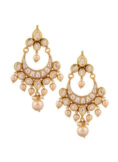 Yosshita & Neha bring together kundan and pearls in this pair of chandeliers that can make any traditional outfit look absolutely stunning with its elegant design and remarkable craftsmanship. The earrings are encrusted with kundan and a crescent shaped kundan bali with dainty dangling pearls. Simple, elegant and stunning, these earrings are a must have in your closet.