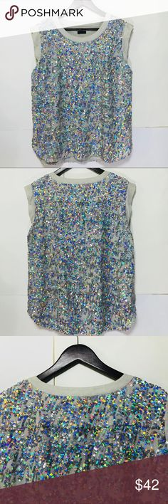 J.CREW COLLECTION SEQUINS TOP SLEEVELESS SIZE XL J.CREW COLLECTION SEQUINS TOP SLEEVELESS SIZE XL MULTICOLOR  Shine bright like a diamond in this beautiful sequin top . Size xl  Shoulder 18 inches  Bust 44 inches  Front Length 22 1/2 inches  Back Length 26 inches J. Crew Tops