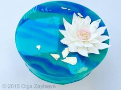 Learn how to make this trendy cake with a mirror effect – a Two-tone Mirror Glaze Cake with chocolate Water Lily flower.