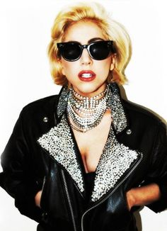 Lady Gaga black shades + black leather biker jacket