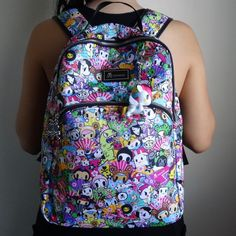 "Super cute backpack is great for everyday use at school or while traveling! Size: 12.5"" wide x 16"" high x 5.5"" deep -Shell and Lining: 100% Polyester. Trim: 100% Polyurethane - Zip front closure - Two"