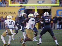 ASU quarterback Taylor Kelly throws during the fourth