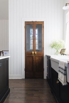 Pantry Door Kitchen pantry door Pantry door ideas pantry features vintage-looking double doors with antique hardware #pantry #pantrydoor #pantrydoors