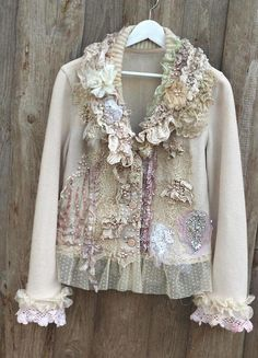Vintage porcelain and winter shades inspired cream wool jacket, made of felted wool jersey, reworked with intricate details to discover. The color is warm soft cream, as well the decorations in various shades of off white, smoke white, cream, pale beige, some silk petals with palest