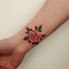 This watercolor-inspired pink wrist rose tattoo is amazing! See more beautiful rose tattoos for women right here.