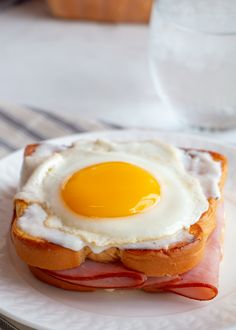 This variation on the Croque Monsieur is served with a poached or sunny-side up egg on top! (The egg is said to resemble a woman's hat, hence the name).