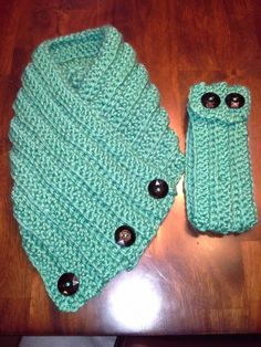 Local Cedar Rapids crocheter.... The scarf is roughly 32 inches long by 14 inches wide. There are three buttons attached, that you simply not button, if wanted