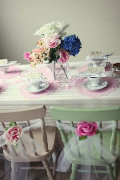 Doilies and little gloves... Such soft, sweet hues at work here. #tulle #chairs #flowers #party #girls #feminine #decor #decorations #table_setting #pink #white #blue #tea #birthday