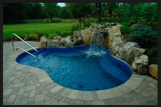 Small backyard pool with waterfall