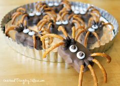 Reeses Spider   REESE'S Peanut Butter Pumpkins  Large pretzel twists (can use gluten-free pretzels)  1/4 cup Chocolate Chips (this is enough for about 8 spiders)  White YORK PIECES Candies