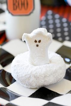 CUTE Ghost Donuts! Perfect for a Halloween breakfast treat! Put a Halloween Peep into a powdered sugar donut!