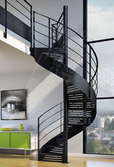 Escalier d'intérieur métallique en colimaçon pour une décoration industrielle et contemporaine. Marches en tôle lisse pliée formant contremarche ajourée par découpe 'Graphique'. Le limon en tôle roulée souligne les courbes de l'escalier hélicoïdal. Finition : acier brut patiné