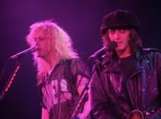 Izzy and Duff onstage.