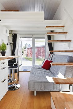A custom tiny house by Tiny Living Homes. A 310 sq ft tiny home on wheels with two lofts.