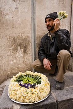 Damascus, I know this man. Bought bouquets of violets from him. He is a romantic and takes time to make good displays