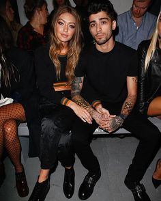 Gigi Hadid and Zayn Malik shared their first joint front row appearance at Versus Versace's Spring 2017 show.