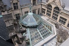 Rooftop of Biltmore House with Gargoyles and leaded glass roof of the winter garden.   http://writerlysam.com/2014/04/08/architects-of-illusion-echoes-of-olympus-1-gargoyles-grotesques-bears/