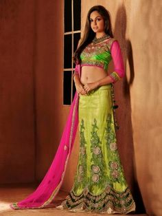 Lime and pink embroidered Lehenga Choli which is nicely embroidered, multi threaded, patch worked and stone worked in net santoon and dhupion fabrics. The very fresh Lehenga collection available. Lehenga Style Saree, Bollywood Lehenga, Lehenga Choli Online, Lehenga Saree, Anarkali, Indian Bridal Sarees, Bridal Lehenga Choli, Indian Lehenga, Ghagra Choli
