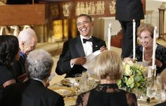 U.S. President Barack Obama laughs at a dinner after presenting the Presidential Medal of Freedom to Israeli President Shimon Peres (2nd L) in the East Room of the White House in Washington June 13, 2012.