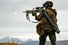 Norwegian Army soldier with FN Minimi and M72 [975x651]
