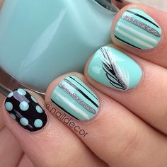 Turquoise, Black, and White with Sliver Glitter, Strips, Polkadots, and a Feather Nail Art Design