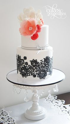 Beautiful White Cake with Black Lace Detail and Large Coral Flower