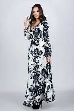 Long sleeve belted maxi dress with black flowers. Perfect for work day and cocktail hour later! Fabric: 100% Polyester Color: Black / White