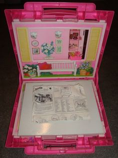 Barbie Fold and Fun house!  it took my Dad my papa my uncle and brother to put this together when i got it lol