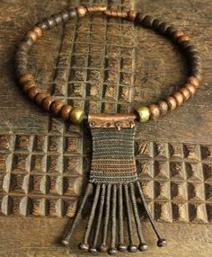 Africa | Neck adornment from the Karamojong people of Uganda | Worn by married women to signify her important status | Mixed metal | Mid 20th century | Sold