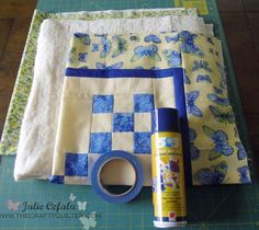 basting a quilt with spray adhesive rather than sewing basting stitches from the center out, sounds much easier