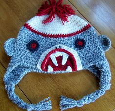 Ravelry: Zombie Sock Monkey Attacks Hat (with or without earflaps) pattern by Darleen Hopkins  Of course one of my kids wants this so bad.