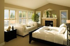 Very pretty Guest Bedroom. I like the backless sofa for an overflow/kids bed & of course the cozy fireplace!