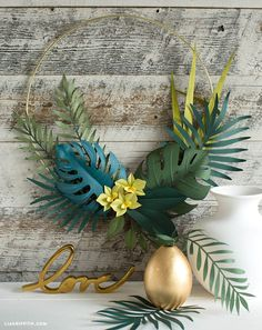 simple tutorial to make a gorgeous DIY tropical wreath complete with palm leaves, monstera and orchid blooms.