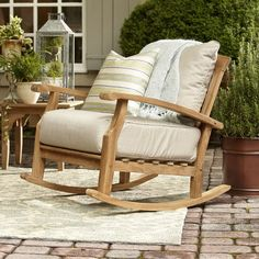 Sip a refreshing cocktail while you watch the sunset from this weather-resistant teak wood rocking chair, perfect for the beach house or patio.