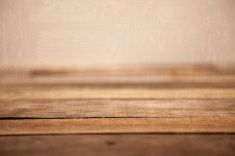 Grunge, rustic wooden table with textured background. stock photo