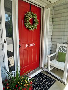 Painted front door with house number